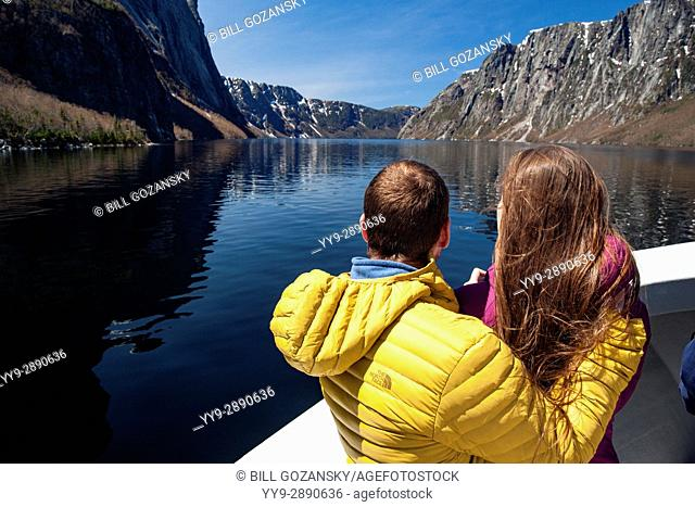 Young couple on boat tour on Western Brook Pond, Gros Morne National Park, Newfoundland, Canada