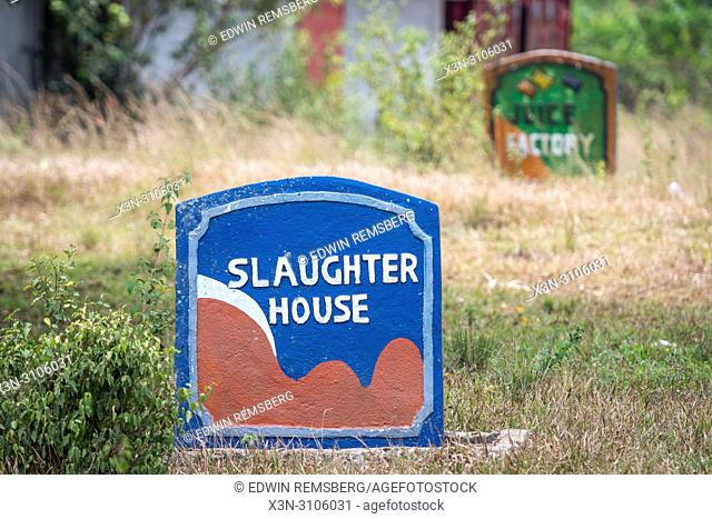 "A colorful tombstone reads """"Slaughter House"""" in Ganta, Liberia"