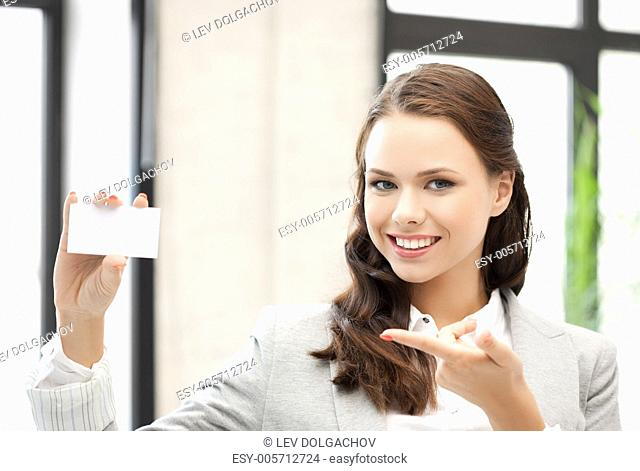 smiling and confident woman with blank business card