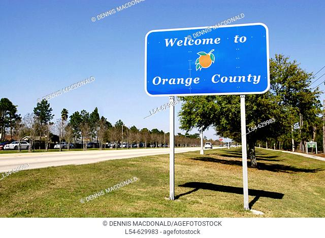 County road sign Welcoming Drivers to Orange County Kissimmee Orlando Disney Theme Park Area. Florida. USA