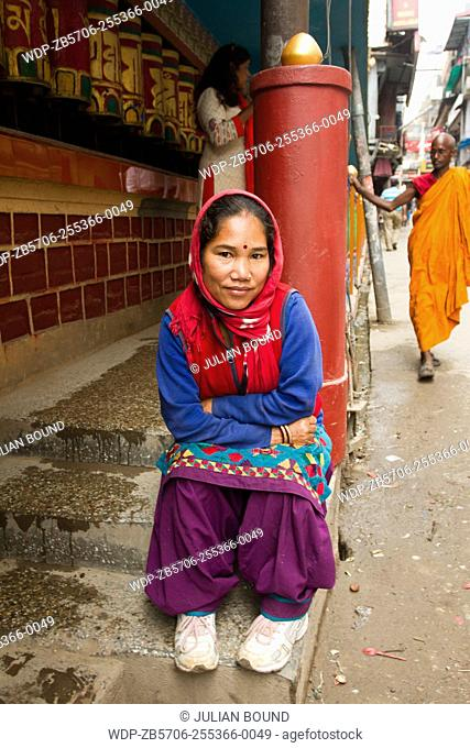 A Tibetan refugee sits on the steps of a Temple in the heart of Mcleod Ganj, Dharamsala, India