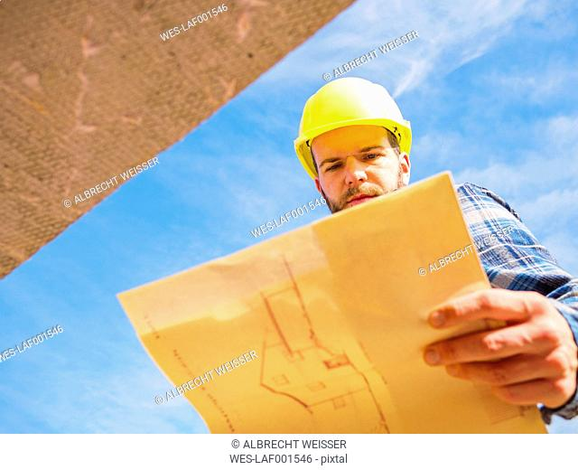 Foreman looking at construction plan