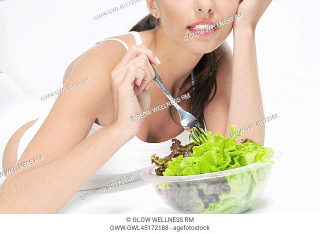 Close-up of woman eating salad