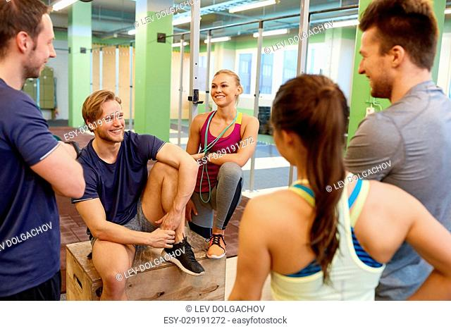 fitness, sport, exercising and healthy lifestyle concept - group of happy people in gym