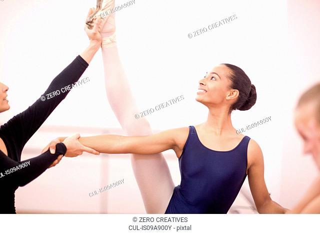 Portrait of teenage ballerina and teacher