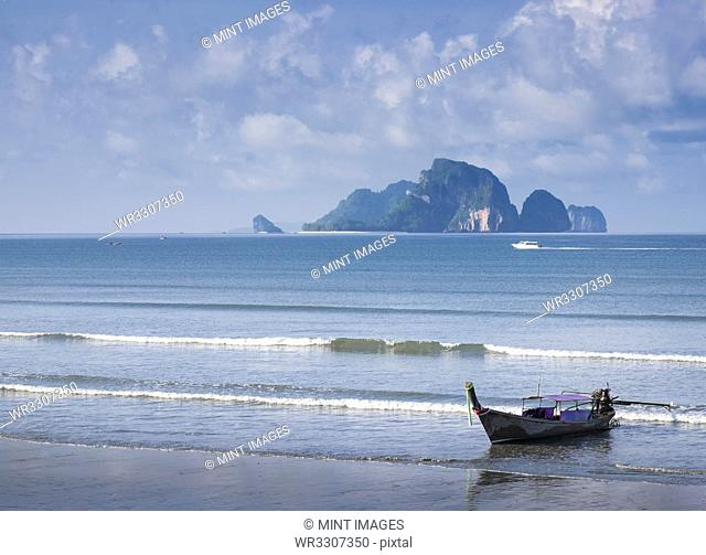 Fishing boat moored on beach