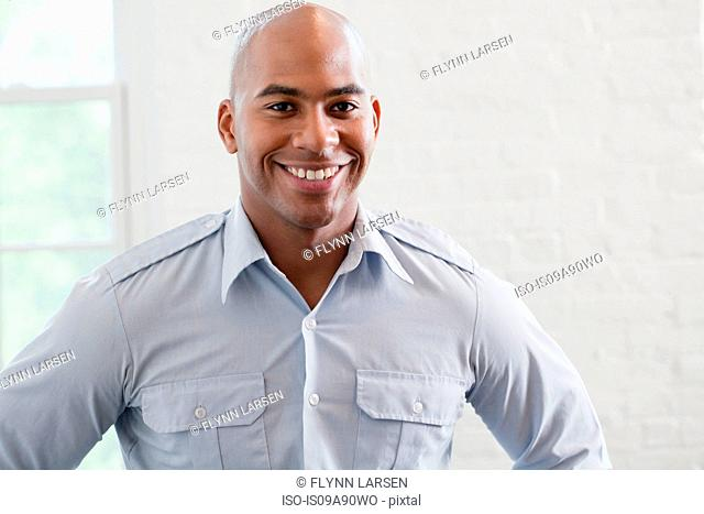 Mid adult office worker smiling, portrait