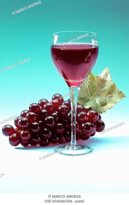 red grape bunch and a glass of wine