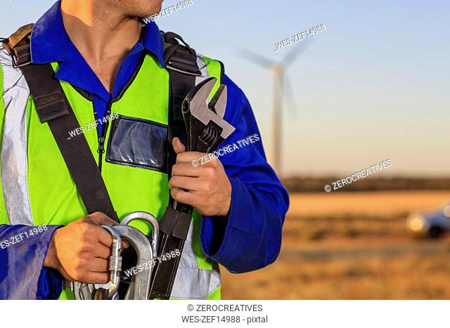 Close-up of technician with equipment on a wind farm