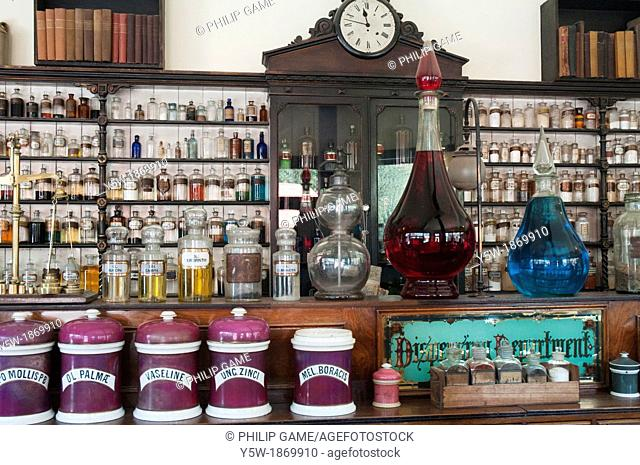 Counter and shelves at the pharmacist's store at the Blists Hill Victorian Town, Ironbridge Gorge, Shropshire, England