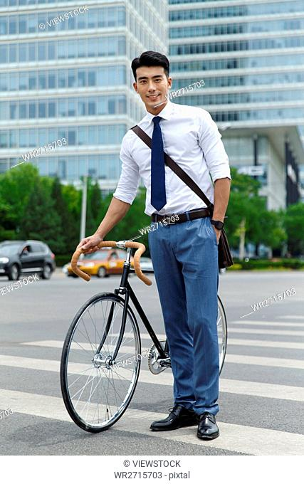 The young man pushed the bicycle