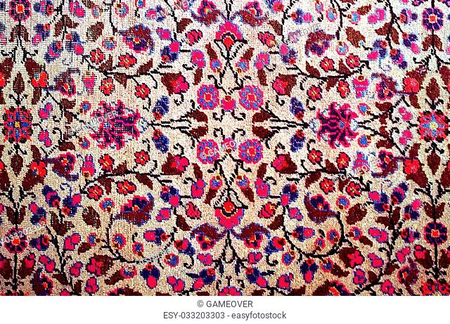 pattern background, antique worn oriental carpet with floral stylized texture