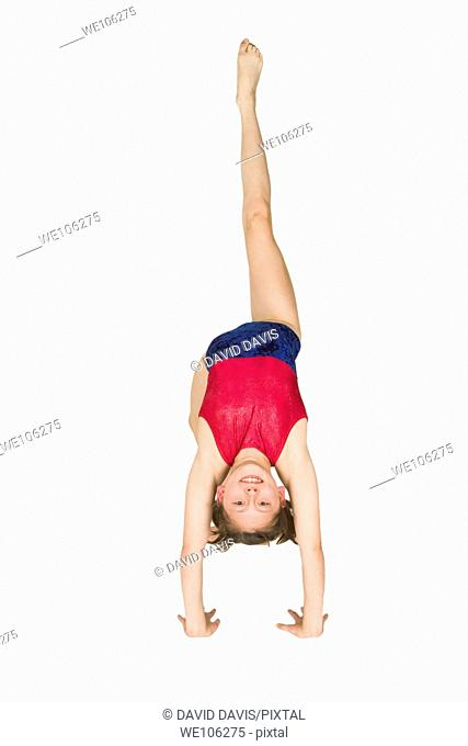 Ten year old caucasian girl in gymnastics poses