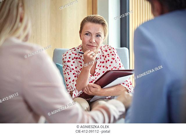 Therapist listening to couple in couples therapy counseling session