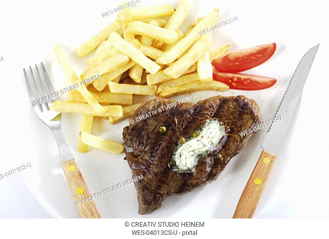 Rumpsteak with french fries on plate
