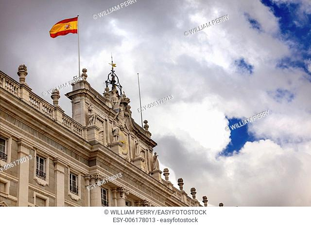 Royal Palace Palacio Real Clouds Sky Cityscape Spanish Flag Madrid Spain. Phillip 5 rreconstructed palace in the 1700s
