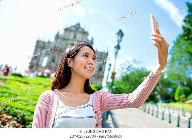 Woman taking self image by smart phone in Macau city