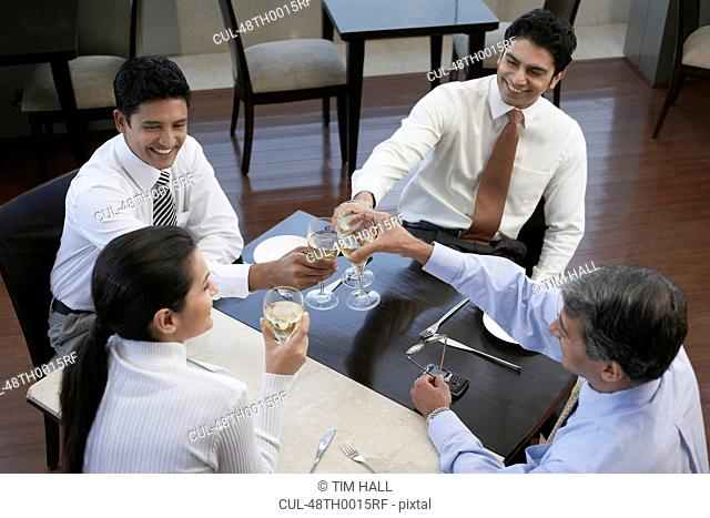 Business people toasting each other