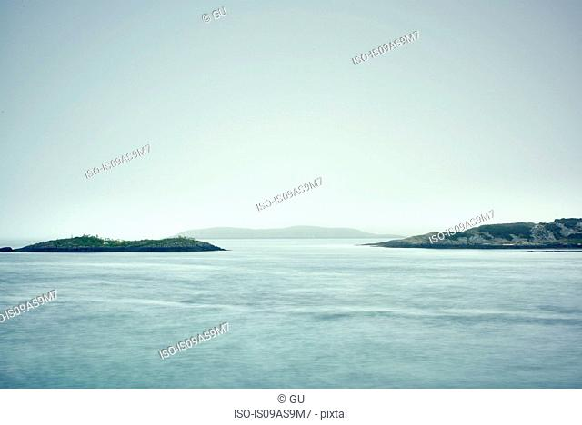 Misty view across water of rocky islands, Haugesund, Rogaland County, Norway