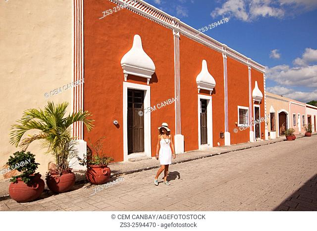 Tourist woman walking in the street at the old town, Valladolid, Yucatan Province, Mexico, Central America