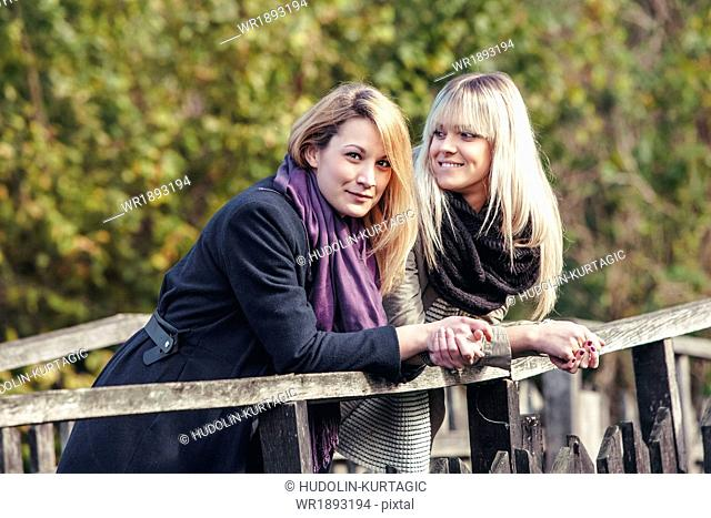 Portrait of two young women outdoors
