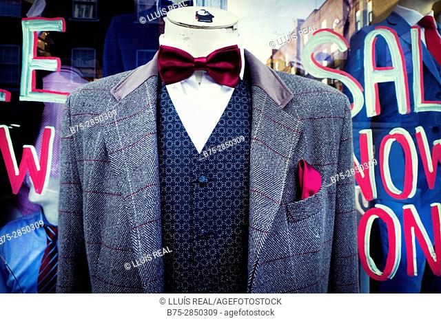 Close-up of a headless mannequin wearing a tweed blazer, vest, shirt and bow tie. Petticoat Lane Market, East End, London, England