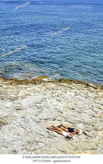Two young women on the beach. Chersonissos, Crete, Greece