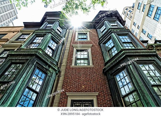 New York City, Manhattan, Upper East Side. Looking Up at the Copper Clad Windows of a Town House