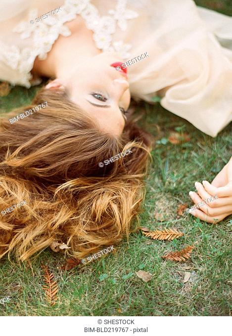 Close up of woman laying in grass