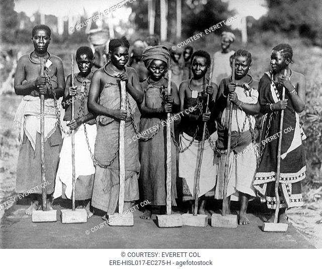 Women convicts working on road while chained together by neck rings in Tanganyika, East Africa ca. 1915