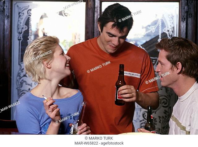 young people drinking a beer at the pub
