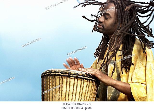 African man playing drum