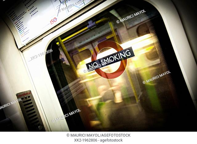 No smoking sing in tube window, London, UK