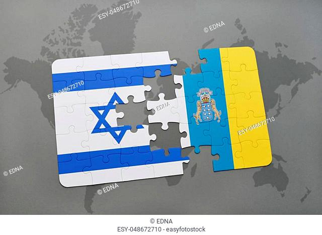 puzzle with the national flag of israel and canary islands on a world map background. 3D illustration