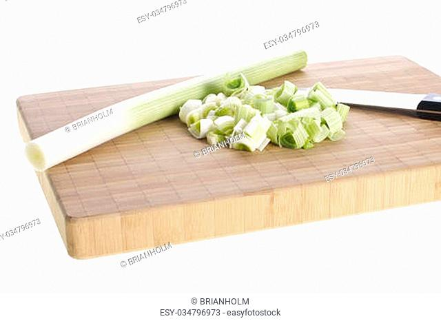 Picture of leeks and a knife on a cutting board