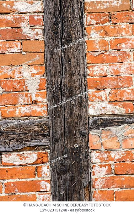 brick wall of an old frame house
