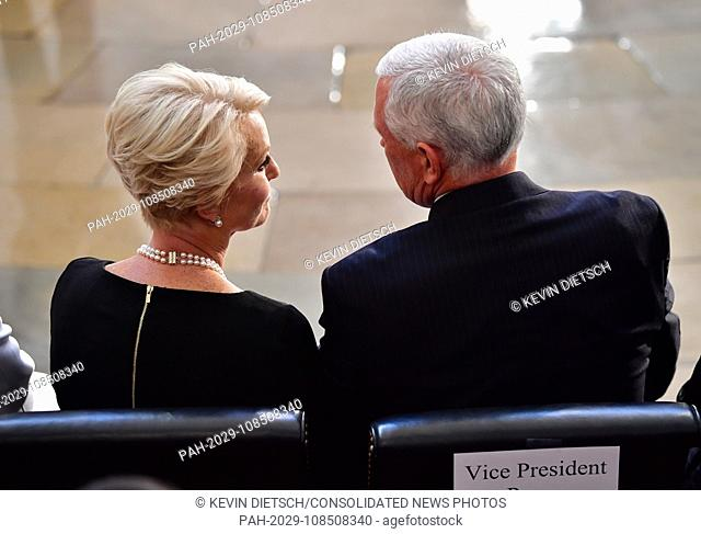 Vice President of the United States Mike Pence sits with Cindy McCain as the casket of former Senator John McCain in the Capitol Rotunda lies in state at the U
