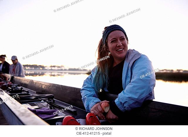 Portrait smiling, confident female rower at scull