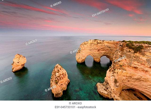 Amazing sunset at Marinha Beach in the Algarve, Portugal. Landscape with strong colors of one of the main holiday destinations in europe