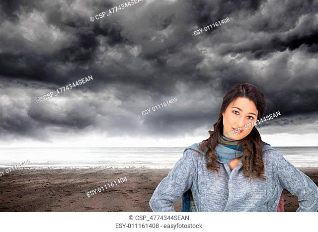Composite image of serious pretty brunette wearing winter clothes posing