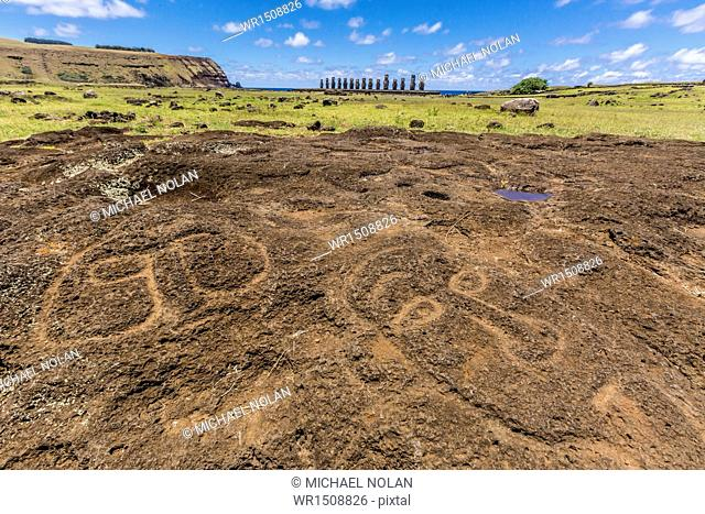 Petroglyphs carved in the lava at the 15 moai restored ceremonial site of Ahu Tongariki on Easter Island (Isla de Pascua) (Rapa Nui), UNESCO World Heritage Site