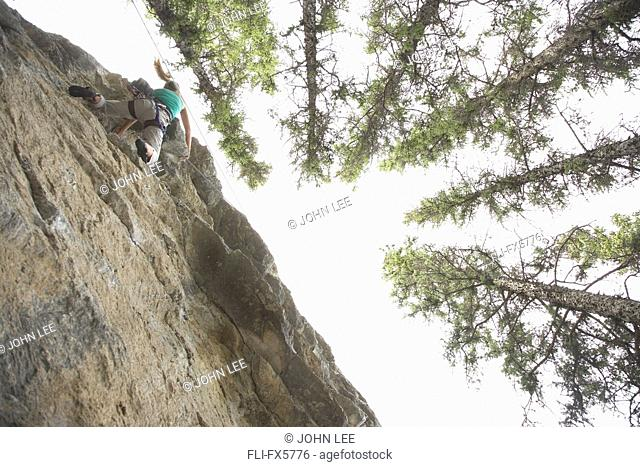Female Rock Climber at the Boulder Garden in Jasper, Alberta