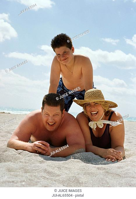 Couple with son on beach