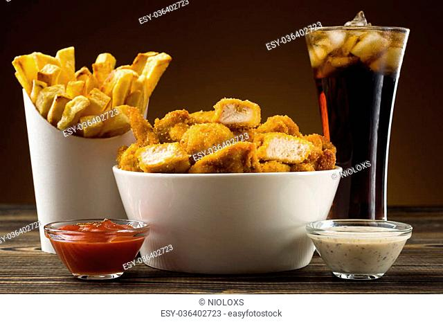 French fries chicken nuggets and cola
