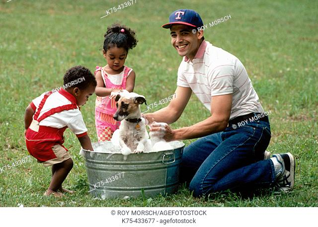 Dad and his children washing dog