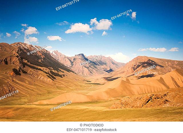 Mountain sandy ridges. View of the high mountains. Mountain valley during sunrise. Summer landscape