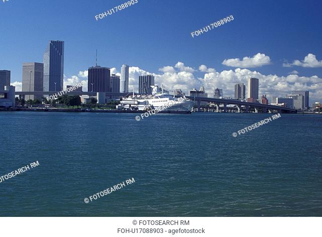 Miami, FL, Florida, Atlantic Ocean, Cruise ship docked at the Port of Miami Biscayne Bay with a view of the downtown skyline of Miami