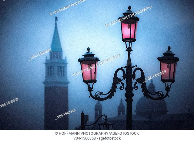 Mystical view of a glowing lantern and the Campanile in Venice, Italy, Europe