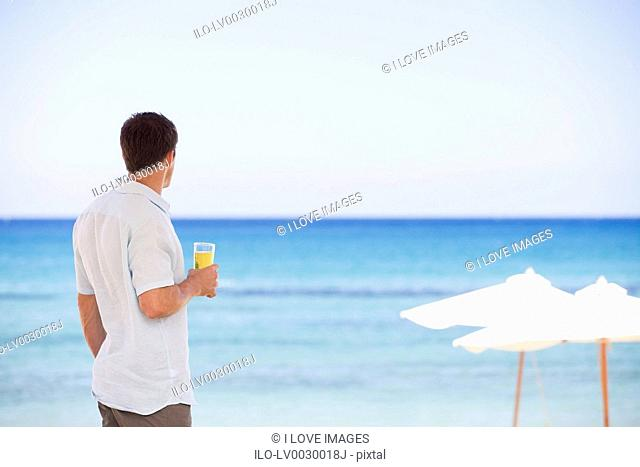 A man relaxing with a drink