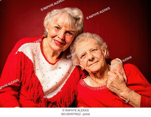 Two senior women hugging